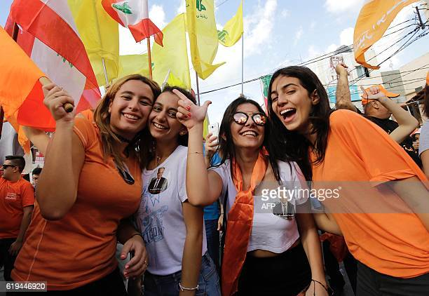 Lebanese people take to the streets of the coastal city of Batroun north of Beirut to celebrate the election of former general Michel Aoun as...
