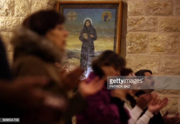 Lebanese pilgrims pray at the shrine of Saint Rafka in the northern Lebanese village of Jrebta on February 10 2016 as they mark her canonisation...