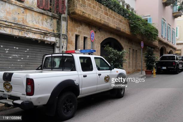 Lebanese police in a pick up truck keep watch outside parking access doors at the property of Carlos Ghosn former head of Nissan Motor Co and Renault...