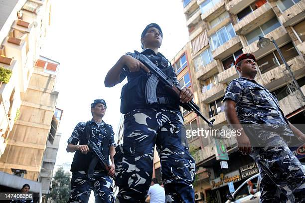 A Lebanese police officer leads female internal security forces on a patrol the Mar Elias district of Beirut on a training assignment on June 27 in...