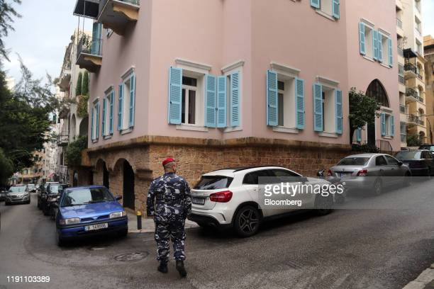 A Lebanese policeman patrols the street outside the property of Carlos Ghosn former head of Nissan Motor Co and Renault SA in Beirut Lebanon on...
