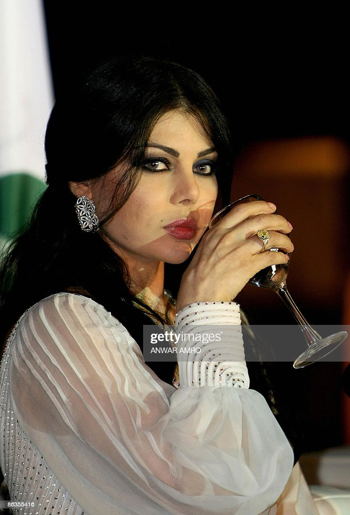 Lebanese Pop Star Haifa Wehbe Drinks During A Ceremony To Celebrate