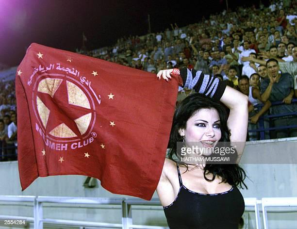 Lebanese pop star Haifa Wehbe holds the flag of Lebanon's Nijmeh team before the friendly game between Nijmeh and the Brazilian Flamengo club late 01...