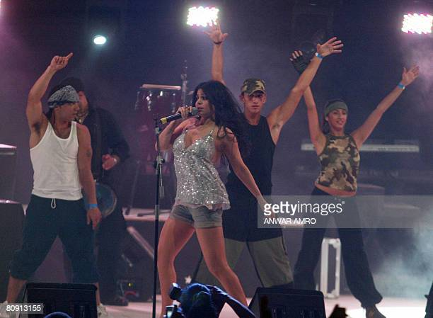 Lebanese pop star Haifa Wehbe performs during a concert with US rapper 50 Cent at Biel hall in downtown Beirut late 10 June 2006 Bahrain's...