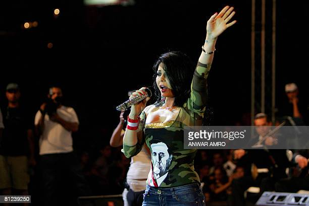 Lebanese pop star Haifa Wehbe wearing a top with army fatigues sleeves and a picture of Lebanon's new president Michel Sleiman printed on it performs...