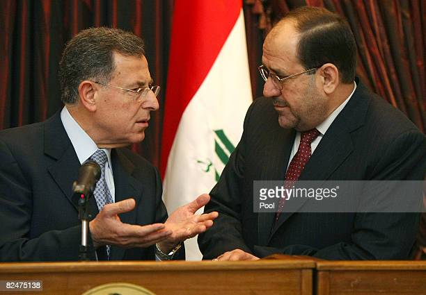 Lebanese Premier Fuad Siniora talks with Iraqi Prime Minister Nuri alMaliki moments before a joint press conference on August 20 2008 in Baghdad...