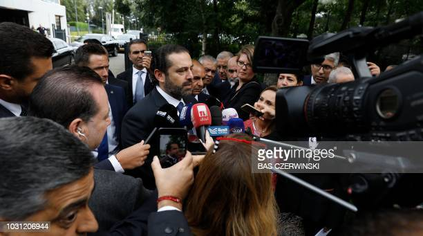 Lebanese premierdesignate Saad Hariri speaks to the press in front of the Special Tribunal for Lebanon after the presentation of the closings...