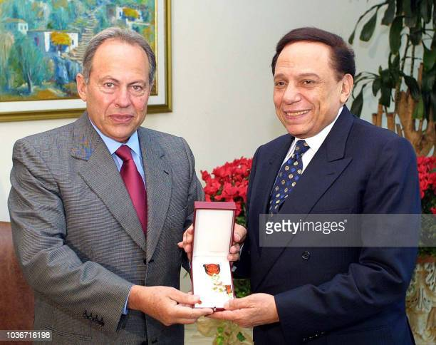 Lebanese President Emile Lahoud awards Egypt's top comedian and UN good will ambassador Adel Imam the National Order of the Cedar with the rank of...