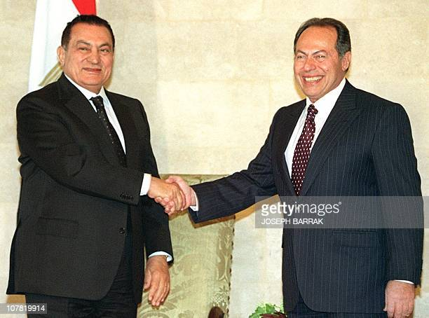 Lebanese President Emile Lahoud shakes hands with his Egyptian counterpart Hosni Mubarak at Baabda presidential Palace in east Beirut 19 February...