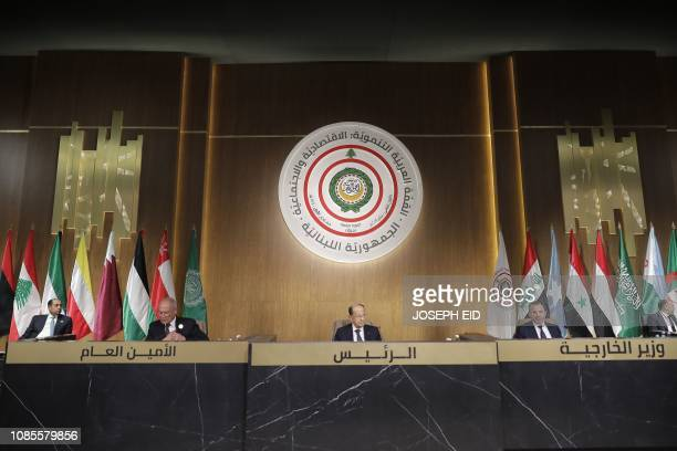 Lebanese President Michel Aoun Arab League Chief Ahmed Abul Gheit and Lebanese Foreign Minister Gibran Bassil chair a regional economic summit in the...