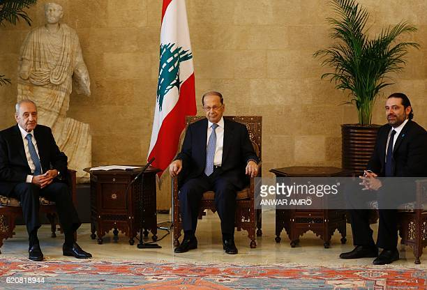 Lebanese President Michel Aoun meets with his newlyappointed Prime Minister Saad Hariri and Parliament Speaker Nabih Berri at the presidential palace...