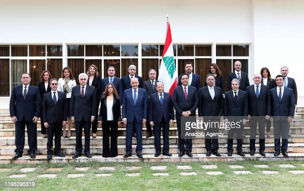 Lebanese President Michel Aoun poses for a photo with Prime Minister-designate Hassan Diab , Speaker of the parliament of Lebanon Nabih Berri at...