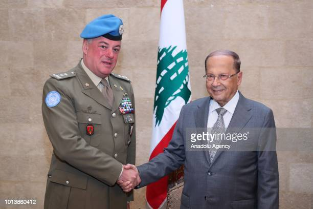 Lebanese President Michel Aoun shakes hands with Head of Mission and Force Commander of the United Nations Interim Force in Lebanon Stefano Del Col...