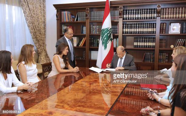Lebanese President Michel Aoun signs the country's first animal welfare bill into law at the Baabda presidential palace on August 29 in the presence...