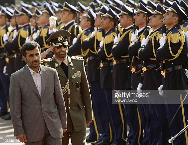 Lebanese President Michel Sleiman and Iranian President Mahmoud Ahmadinejad walk past the Lebanese honor guard at the presidential palace in Baabda...