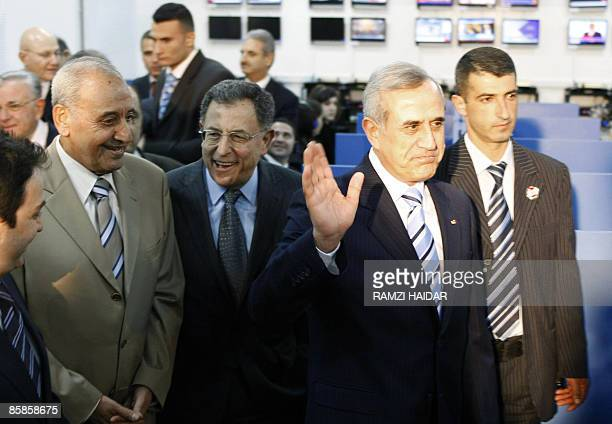 Lebanese President Michel Suleiman waves upon his arrival with Parliament speaker Nabih Berri Interior Minister Ziad Baroud and Prime Minister Fuad...
