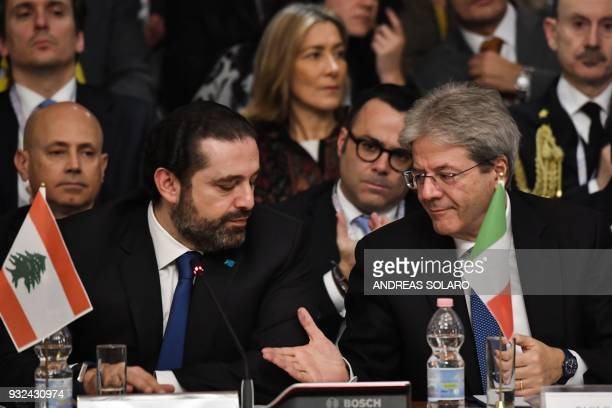 Lebanese Prime Minister and Leader of the Future Movement Party Saad Hariri looks at Italy's Prime Minister Paolo Gentiloni during the Ministerial...