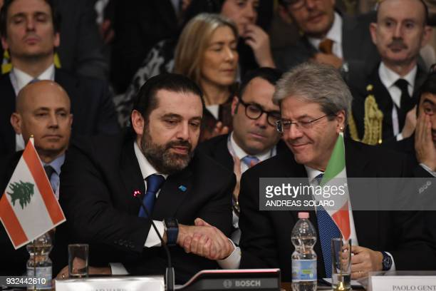 Lebanese Prime Minister and Leader of the Future Movement Party Saad Hariri shakes hands with Italy's Prime Minister Paolo Gentiloni during the...