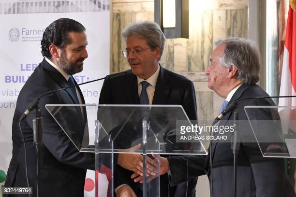 Lebanese Prime Minister and Leader of the Future Movement Party Saad Hariri shakes hands with UN SecretaryGeneral Antonio Guterres next to Italy's...