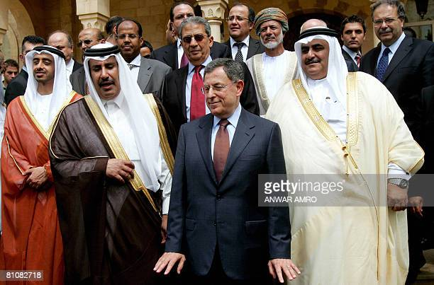 Lebanese Prime Minister Fuad Siniora gestures as he poses for a group picture along with his Qatari counterpart Sheikh Hamad bin Jassem alThani...