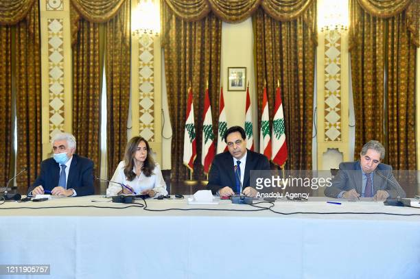 Lebanese Prime Minister Hassan Diab gathers with representatives of international diplomats and international organizations in Lebanon on...