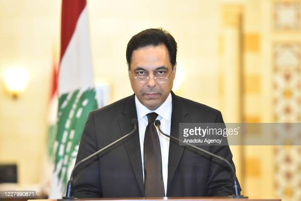 Lebanese Prime Minister Hassan Diab holds a press conference to announce his resignation after the Council of Ministers meeting at the Prime Ministry...
