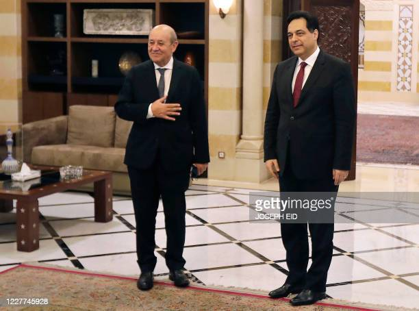 Lebanese Prime Minister Hassan Diab receives French Foreign Minister Jean-Yves Le Drian at the governmental palace in Beirut on July 23, 2020. - Le...