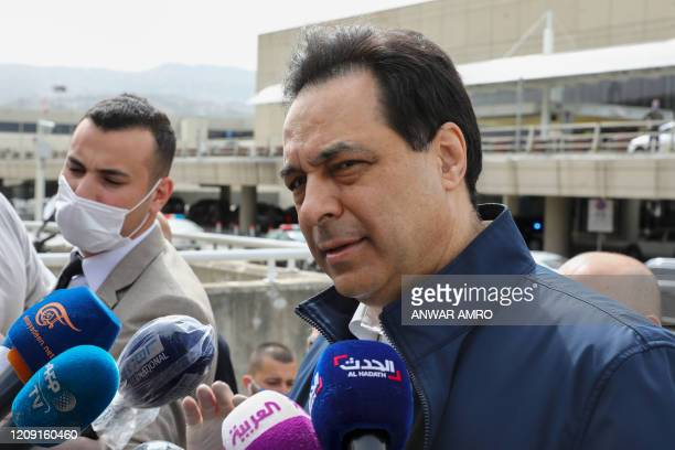 Lebanese Prime Minister Hassan Diab speaks to the media outside the Beirut international airport on April 5 ahead of the arrival of nationals living...