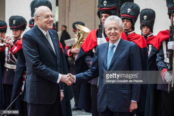 Lebanese Prime Minister Najb Mikati shakes hand with Italian Prime Minister Mario Monti prior a meeting at Palazzo Chigi on December 5, 2012 in Rome,...