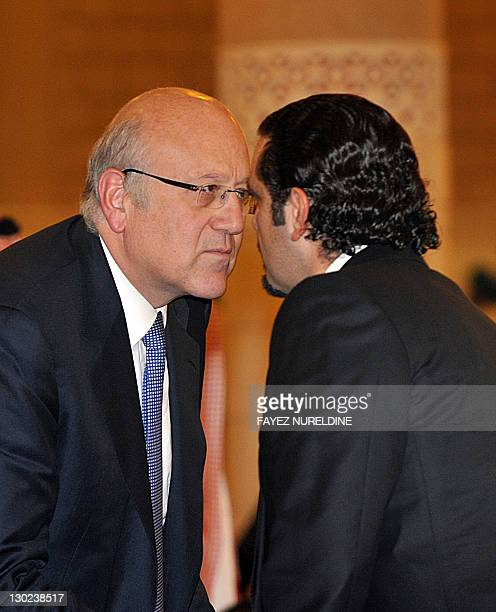 Lebanese Prime Minister Najib Mikati and his predecessor Saad alHariri greet each other as they attend the funeral of late Saudi Crown Prince Sultan...
