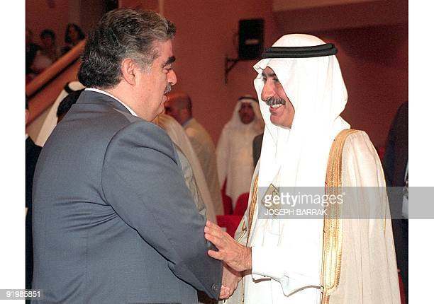 Lebanese Prime Minister Rafic Hariri welcomes Saudi Arabia's Finance Minister Ibrahim alAssaf during the Arab financial institutions annual meeting...