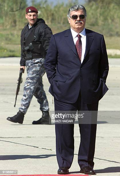 Lebanese Prime Minister Rafiq Hariri awaits the arrival of Syrian President Bashar alAssad at Beirut airport 03 March 2002 AlAssad arrived in Lebanon...