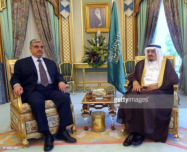 Lebanese Prime Minister Rafiq Hariri sits with Saudi's King Fahd bin Abdul Aziz at a palace in Riyadh 11 July 2004 The Saudi government's decision to...