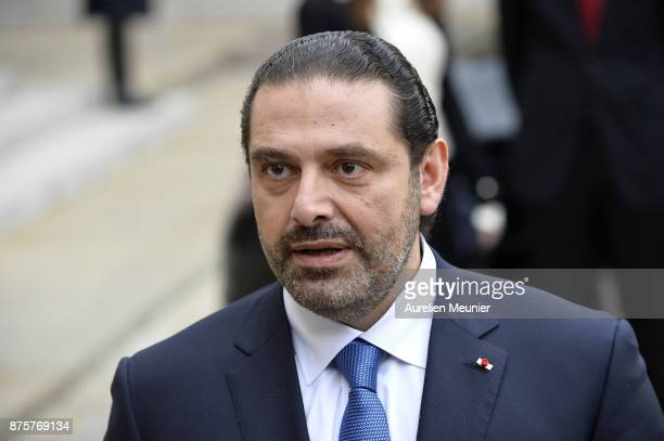 Lebanese Prime Minister Saad Hariri addresses the press as he leaves the Elysee Palace after a meeting with French President Emmanuel Macron on...