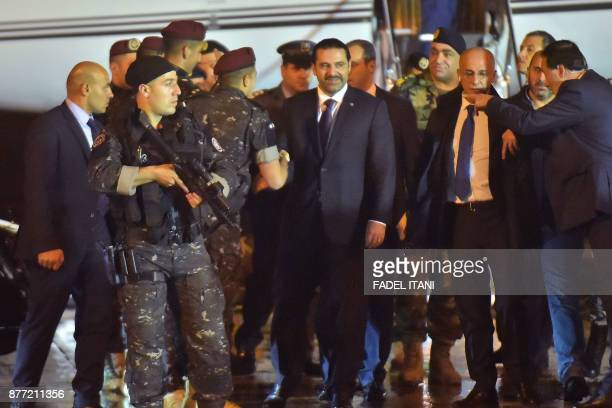 TOPSHOT Lebanese Prime Minister Saad Hariri arrives at Beirut International Airport on November 21 2017 Lebanon's prime minister Saad Hariri returned...