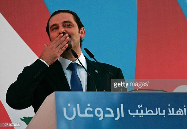 Lebanese Prime Minister Saad Hariri blows a kiss to the crowd during a public gathering with his Turkish counterpart Recep Tayyip Erdogan in the...