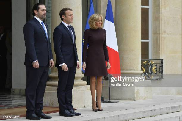 Lebanese Prime Minister Saad Hariri French President Emmanuel Macron and French First Lady Brigitte Macron wait for the Prime Minister's wife for a...