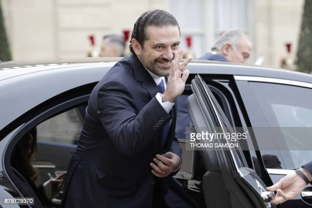 Lebanese Prime Minister Saad Hariri gestures as he steps into a car as he leaves after meeting with French President at the Elysee Presidential...
