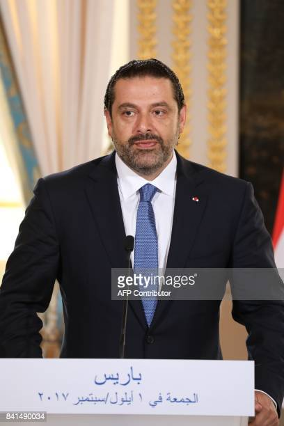 Lebanese Prime Minister Saad Hariri give a press conference with French President at the Murat Lounge in the Elysee Palace in Paris on September 1...