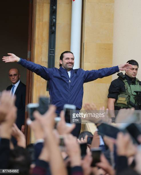 Lebanese prime minister Saad Hariri greets his supporters upon his arrival at his home in Beirut on November 22 2017 Hariri back in Beirut after a...