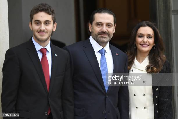 Lebanese Prime Minister Saad Hariri his wife Lara Bachir ElAlzm and their son Houssam pose upon their arrival at the Elysee Presidential Palace on...