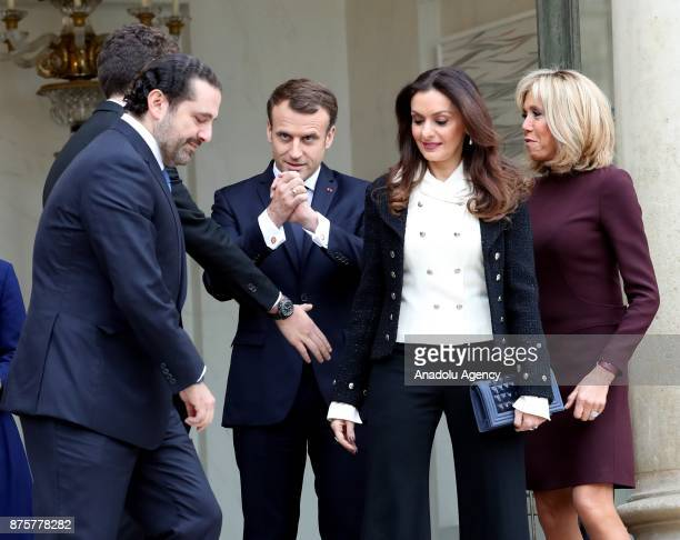 Lebanese Prime Minister Saad Hariri his wife Lara leave as French President Emmanuel Macron and his wife Brigitte accompany at the Elysee Palace in...