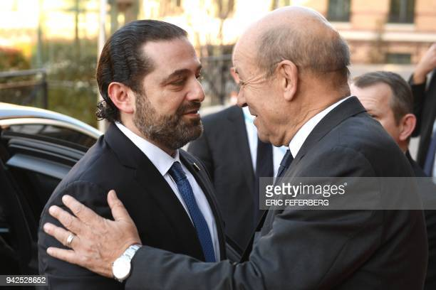 Lebanese Prime Minister Saad Hariri is welcomed by France's Foreign Minister JeanYves Le Drian as they attend the international CEDRE conference in...
