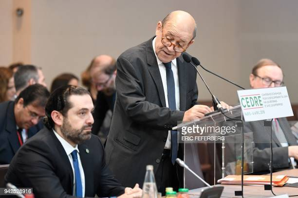 Lebanese Prime Minister Saad Hariri listes to France's Foreign Minister JeanYves Le Drian as they attend the international CEDRE conference in Paris...