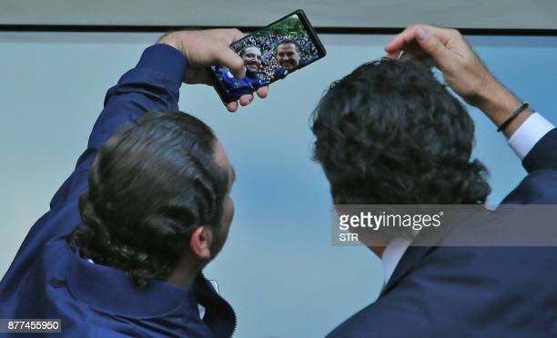 TOPSHOT Lebanese prime minister Saad Hariri poses for a selfie with Lebanese singer Ragheb Alama upon his arrival at his home in Beirut on November...
