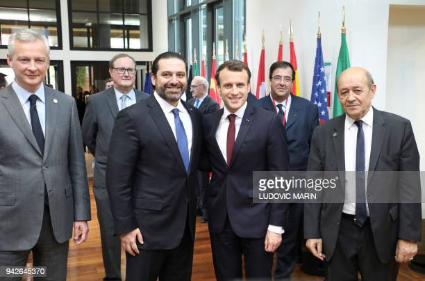 Lebanese Prime Minister Saad Hariri poses with French President Emmanuel Macron French Economy Minister Bruno Le Maire and French Foreign Minister...