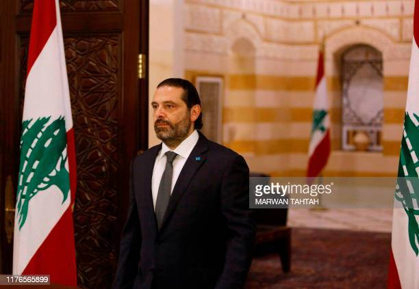 Lebanese Prime Minister Saad Hariri prepares to give an address at the government headquarters in the centre of the capital Beirut on October 18,...