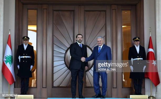 Lebanese Prime Minister Saad Hariri shakes hands with Turkish Prime Minister Binali Yildirim with an official ceremony during his visit at Cankaya...