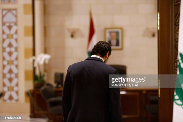 Lebanese Prime Minister Saad Hariri walks after giving an address at the government headquarters in the centre of the capital Beirut on October 18,...