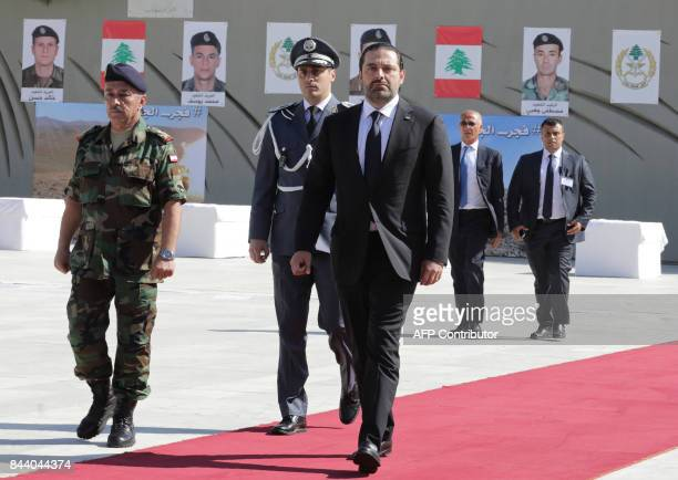 Lebanese Prime Minister Saad Hariri walks during a funerary procession for 10 fallen Lebanese army soldiers who had been taken hostage in 2014 by the...